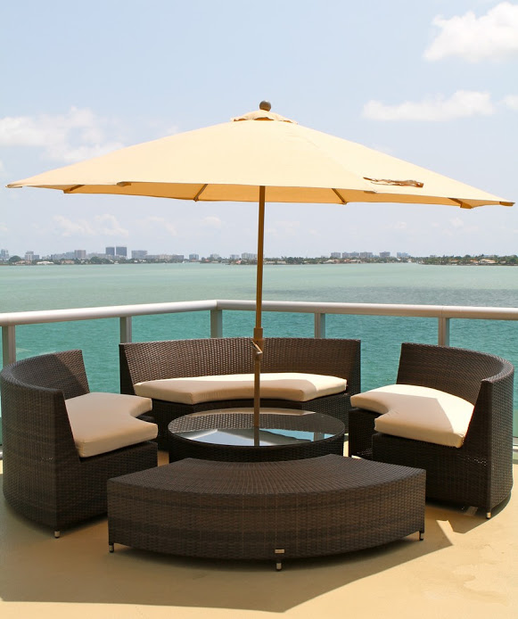 Waterfront seating area with wicker furniture and an umbrella